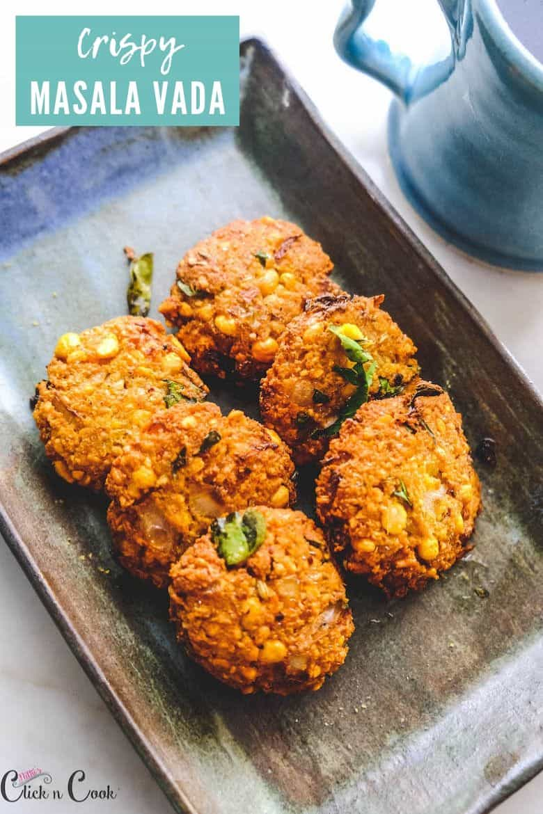 masala vada served in plate with mug of coffee aside