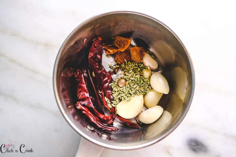 fennel seeds and other spices are in blender jar