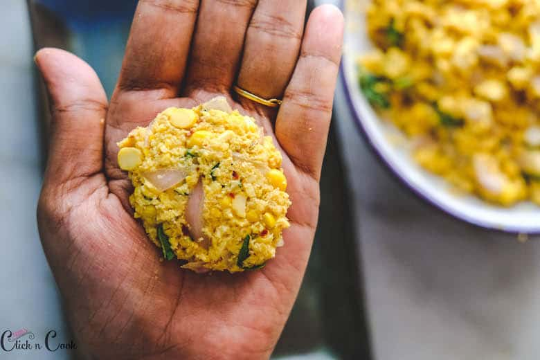 masala vada is being pressed in palm