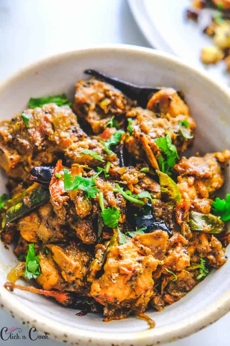 close up shot of pepper chicken served in bowl