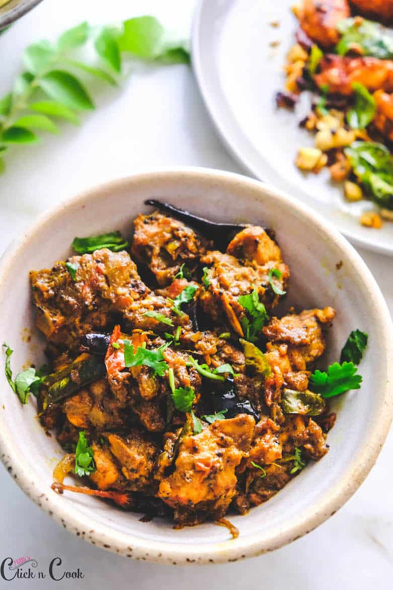 pepper chicken dry is served in bowl
