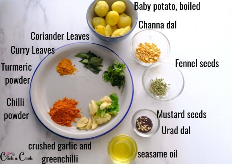 spices and boiled potato are taken in small glass bowl and plate.