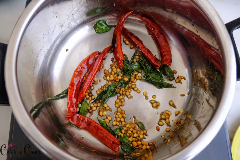spices like coriender seeds and red chillies are roasted well in deep saute pan