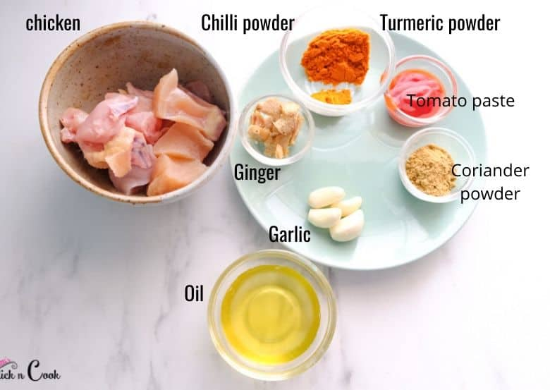 ingredients to make chicken curry are taken in bowls, chicken, ginger, spices are in glass bowls