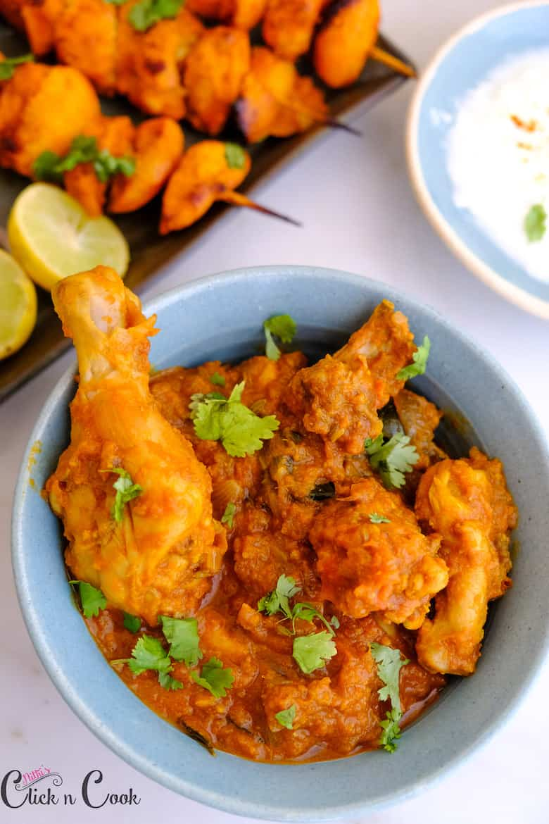 chicken masala gravy is sprinkled with chopped coriender leaves served in bowl