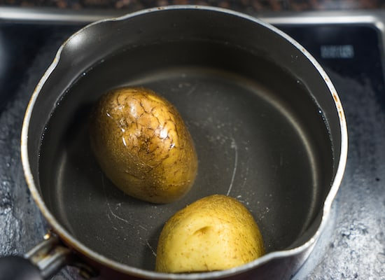 Boil the potatoes, peel out the skin and keep them aside.