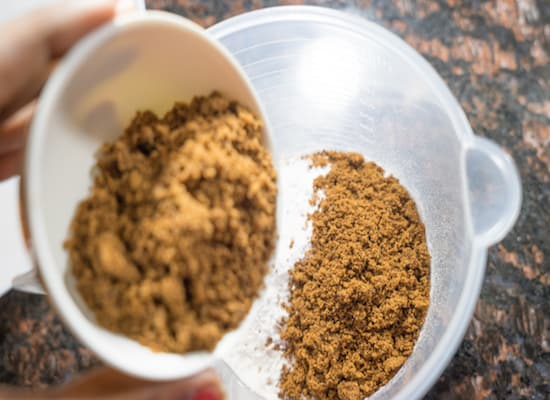In goes the muscovado sugar, adding this sugar it gives a good brown colour to the cake.