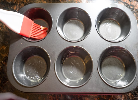 Grease the cupcake pan with butter/oil