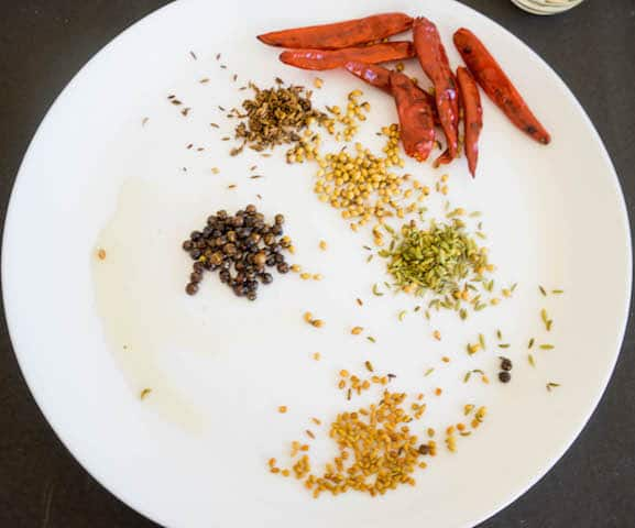 Fry all these ingredients one by one and keep aside.i have taken dryredchilli, pepper,coriander seeds, fennel seeds,cumin seeds, fenugreek seeds.