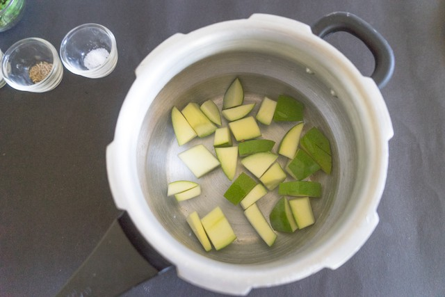Pressure cook the raw mango for 1 whistle or boil them for 10 to 15 minutes..