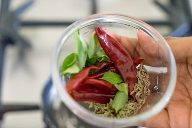 Now, lets do a seasoning : take fennel seeds, cumin seeds, dry red chillies and curry leaves.