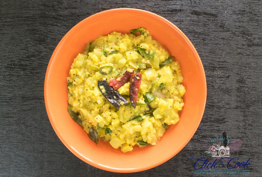 Shot of chow chow kootu recipe seasoned with dryredchillies and curryleaves served in bowl in black woooden backround