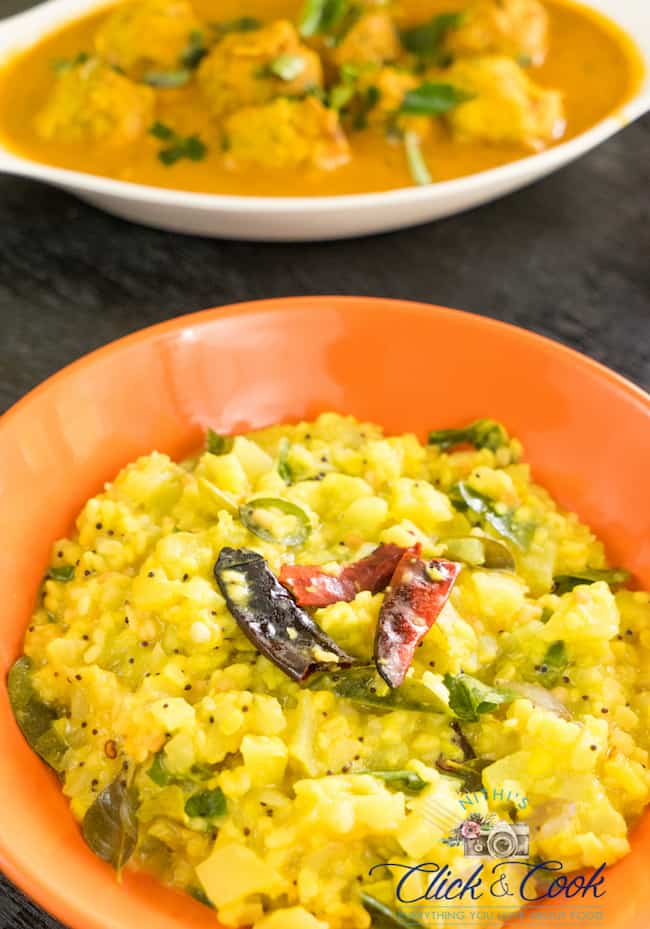 Chayote kootu is seasoned with dryredchili,mustard,curryleaves is placed on the serving bowl with black wooden backround