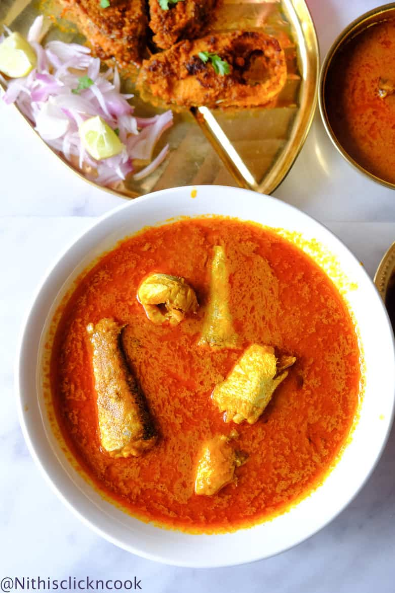 Easy fish curry in a white glass bowl with fish fry aside
