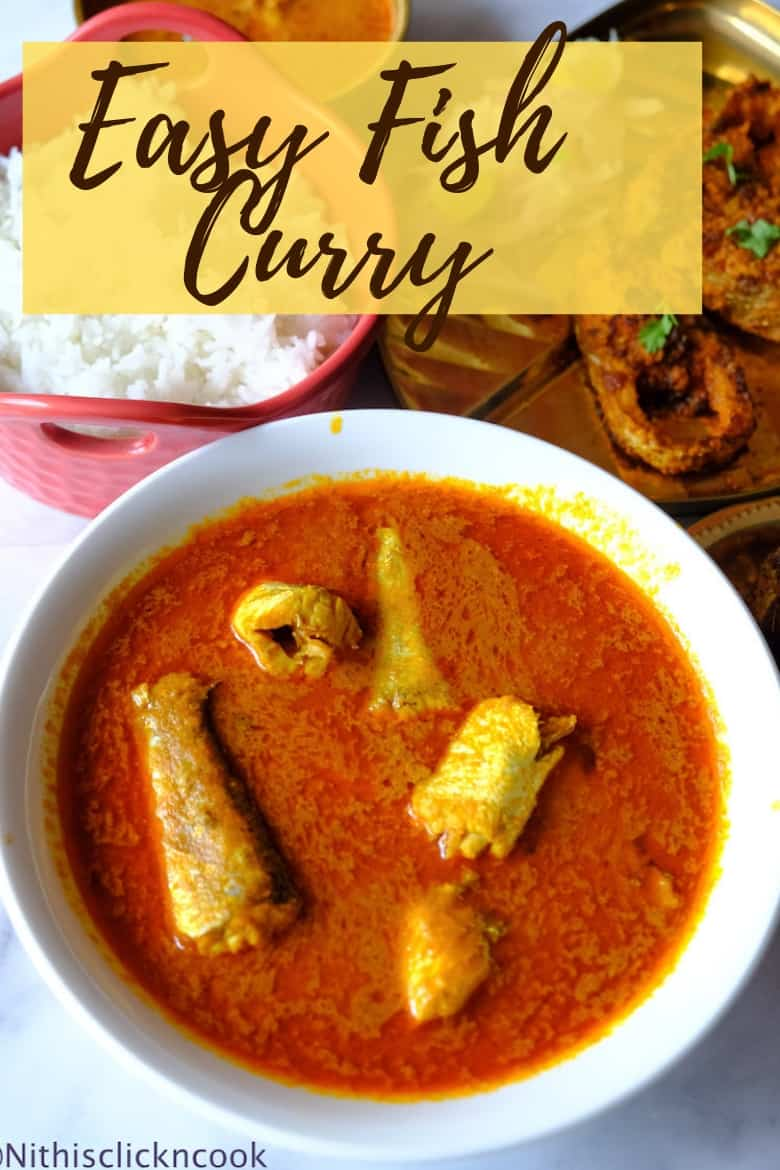 Easy Fish Curry is served in a glass white bowl, with fishes are partially covered with curry.