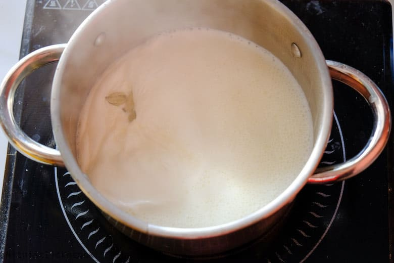 milk is being boiled in sauce pan over the stove