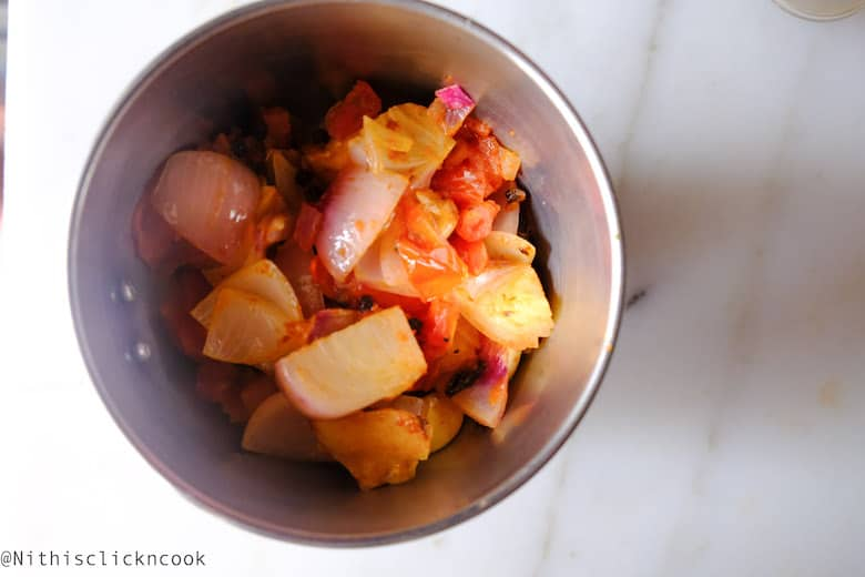 sauted onion-tomato mixture is being added in blender