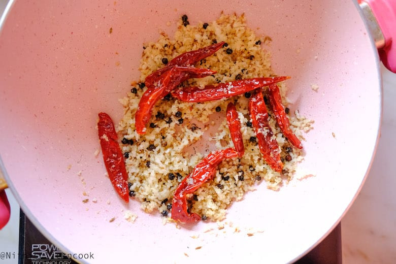 Roasted Grated coconut, pepper corns, dry red chilli in a deep saute pan
