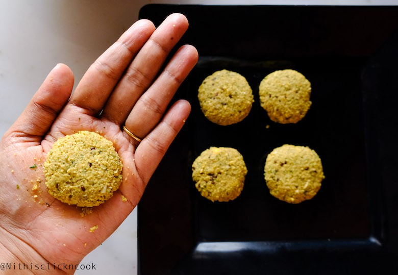 falafel patties are gently pressed in palm