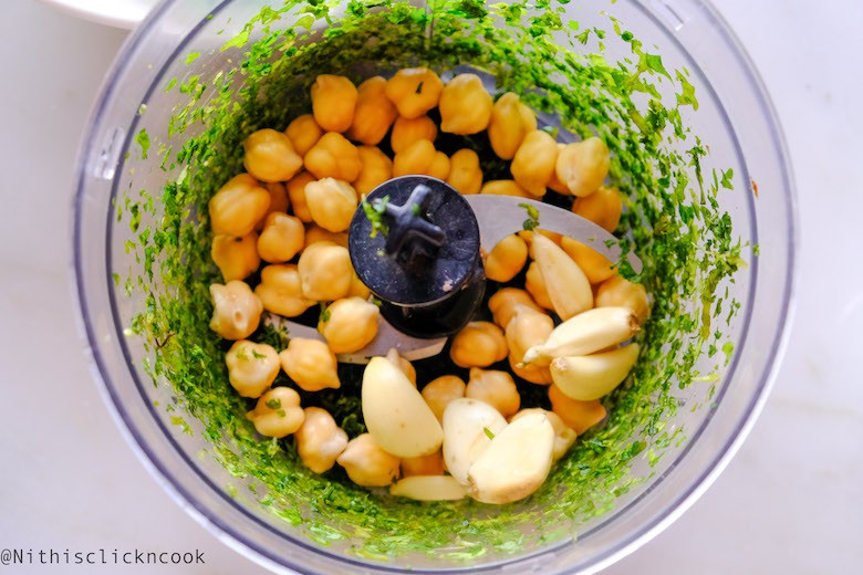 Garlic, chickpeas are in blender along with pulsed greens
