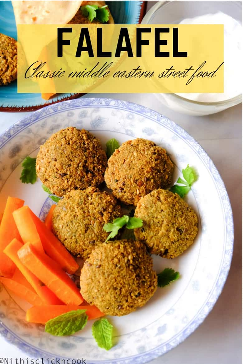 Falafel is served with carrots and sprinkled chopped mint leaves with garlic sauce aside.