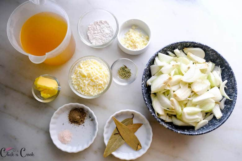 ingredients to make french onion soup are displayed