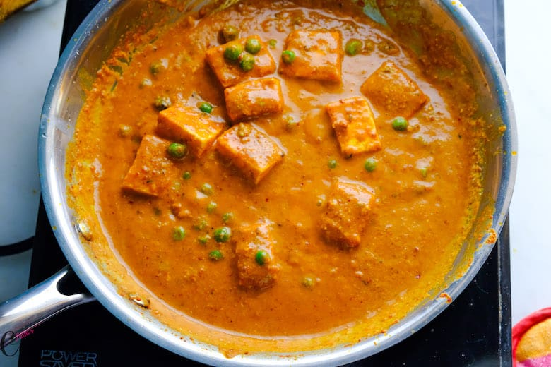 Matar paneer is being cooked well in saute pan