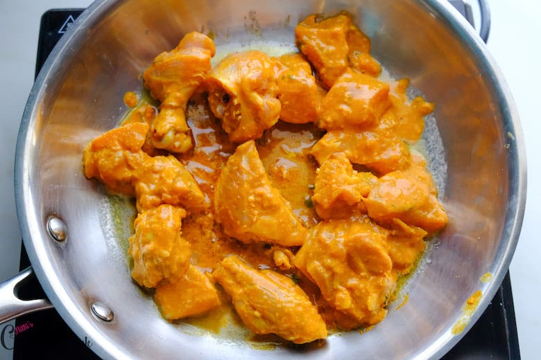 marinated chicken pieces are added to saute pan