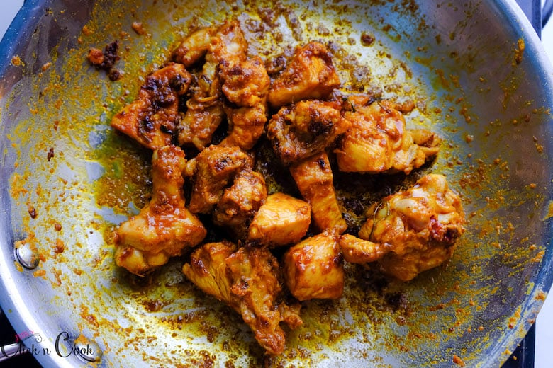 chicken pieces are browned well in saute pan