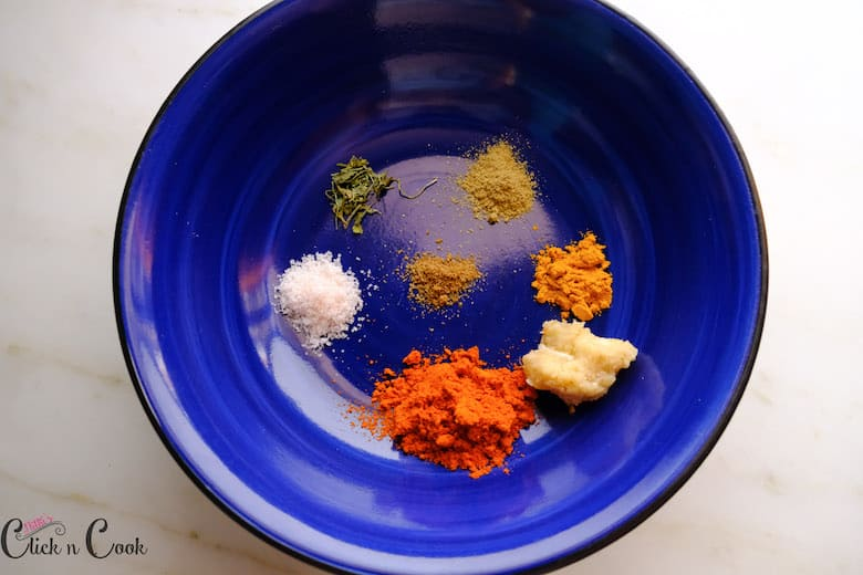 spices are taken in blue mixing bowl