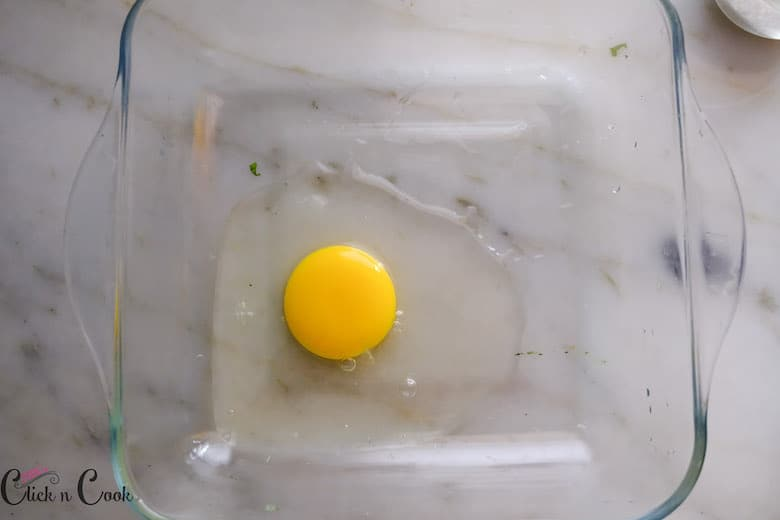 Egg is added to a baking tray
