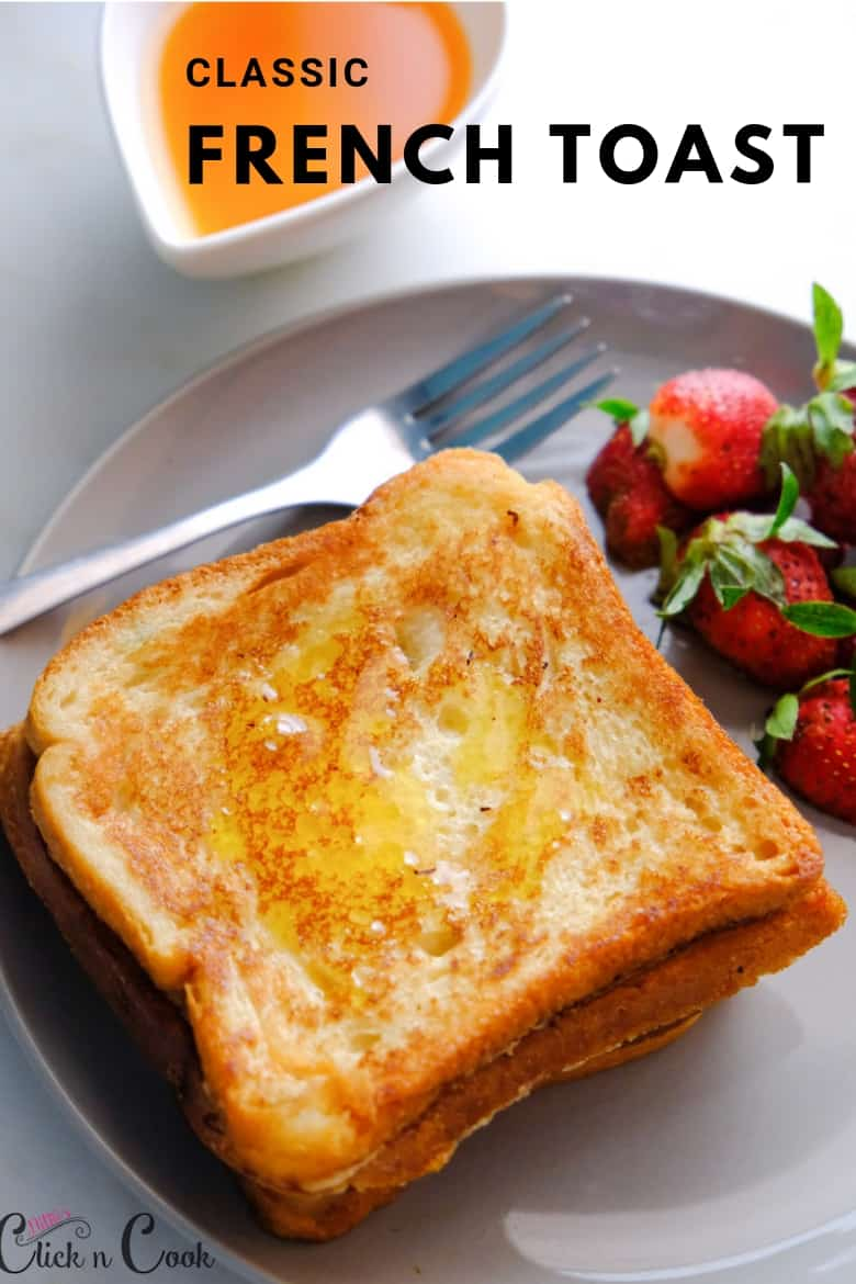 close up shot of french toast bread with fresh strawberries and maple syrup