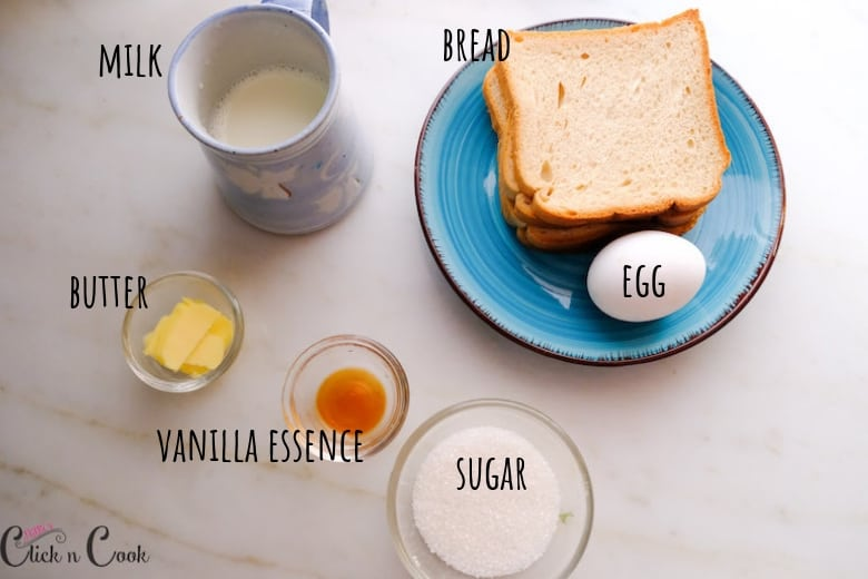 Ingredients to make french toast are take in glass bowls and plate