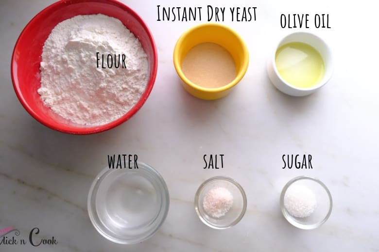 ingredients to make pizza dough is taken in small bowls