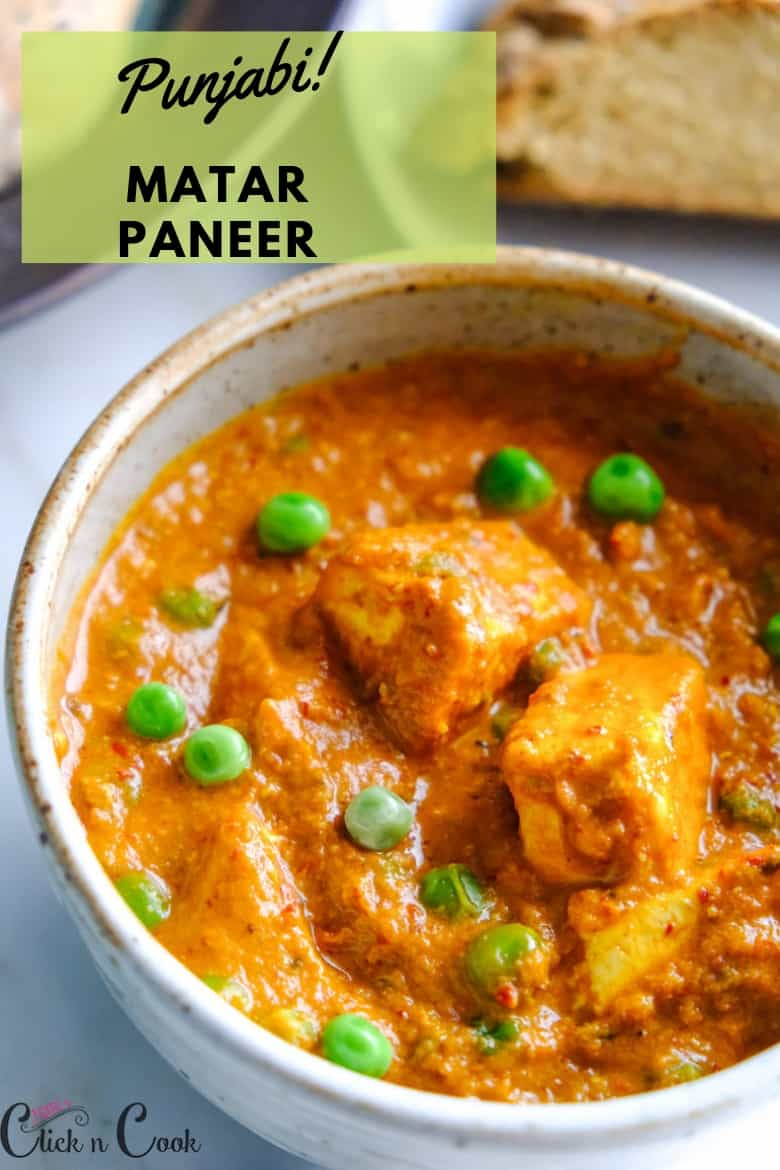Punjabi Matar Paneer served in small bowl sprinkled some green peas