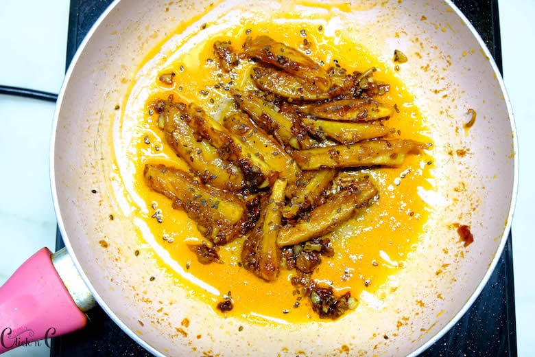 recipe of honey chilli potato is being cooked in saute pan
