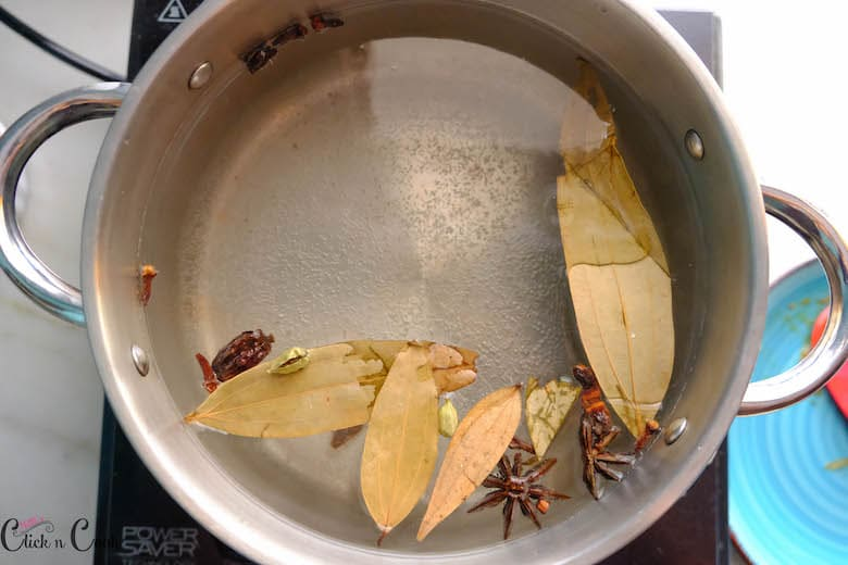 spices are in boiled water in a sauce pan