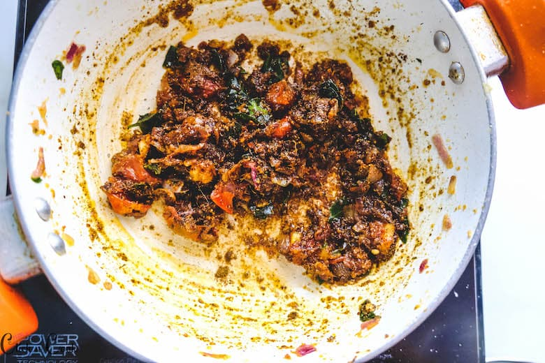 spices are cooked in white saute pan