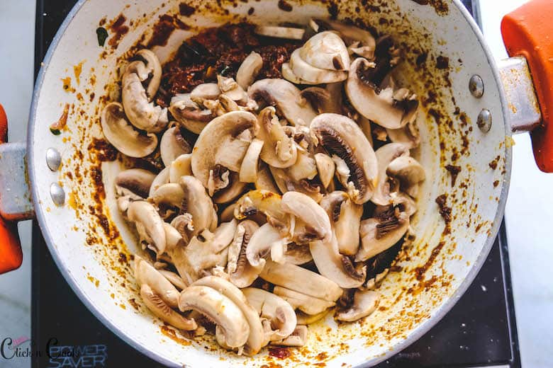 diced mushroom is being added to white saute pan