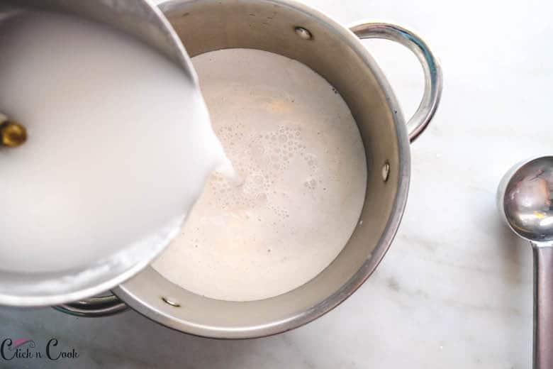 water is being poured to rice batter