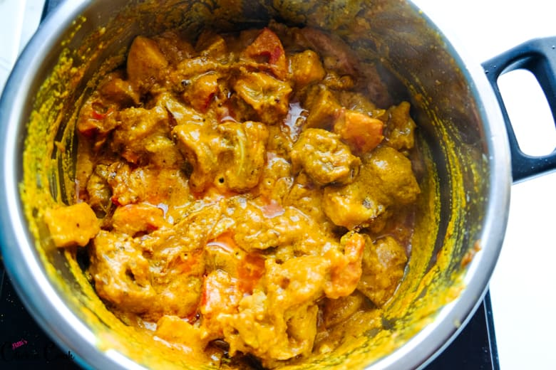 mutton gravy is being cooked in deep pot