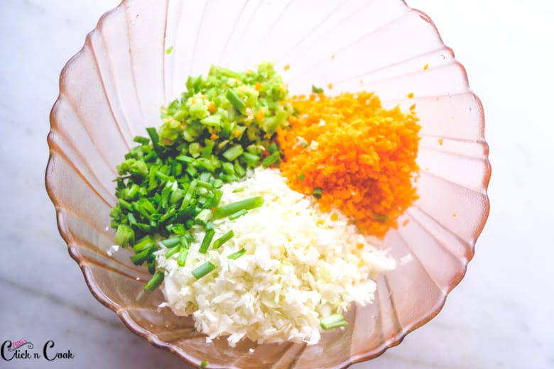 Grated vegetables are in mixing bowl