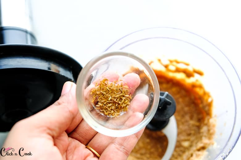 a bowl of cumin seeds are added to food processor