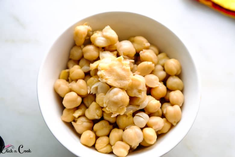 cooked chickpeas in white bowl