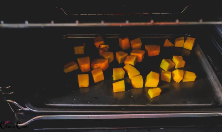 pumpkin is being roasted in oven