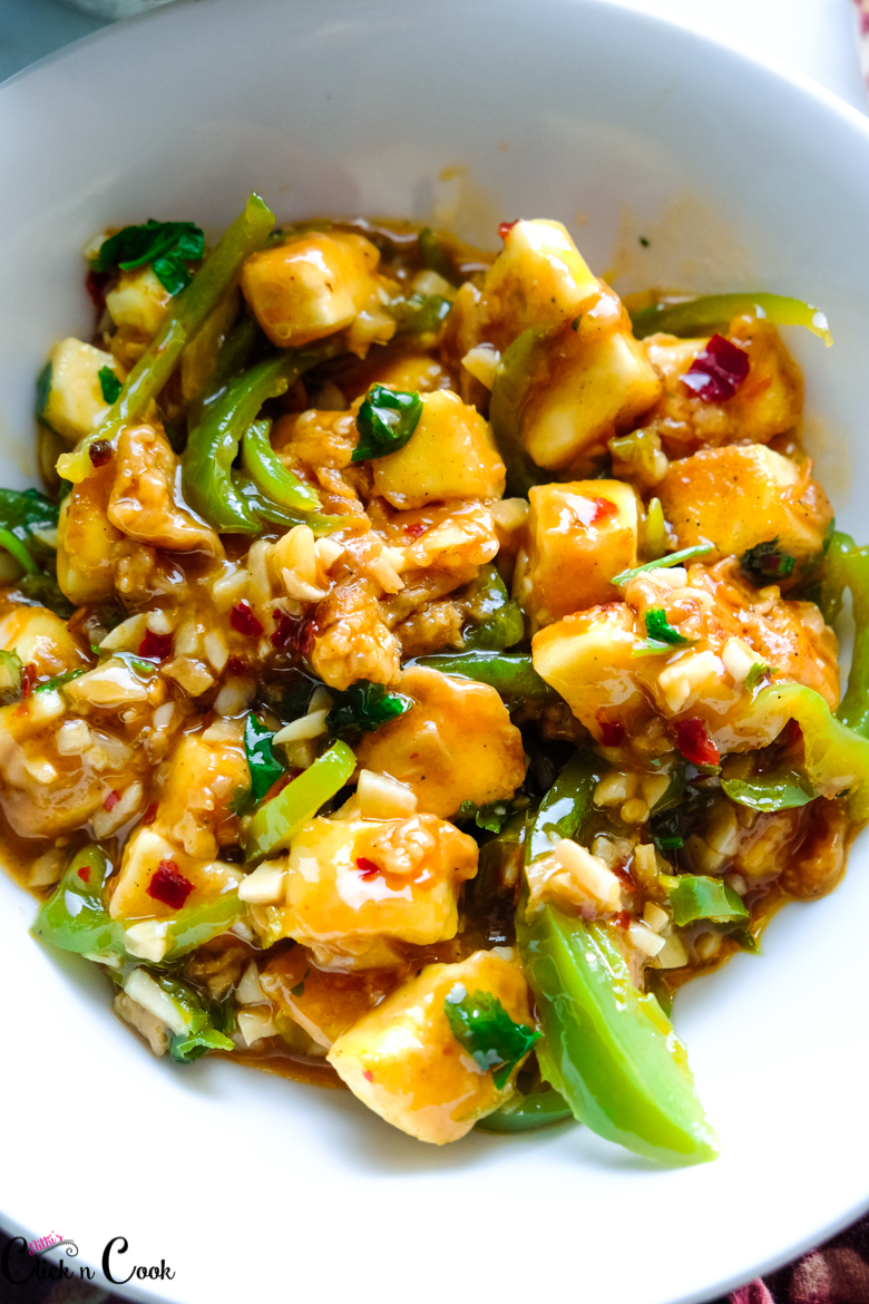 Close up shot of chilli paneer recipe in white bowl