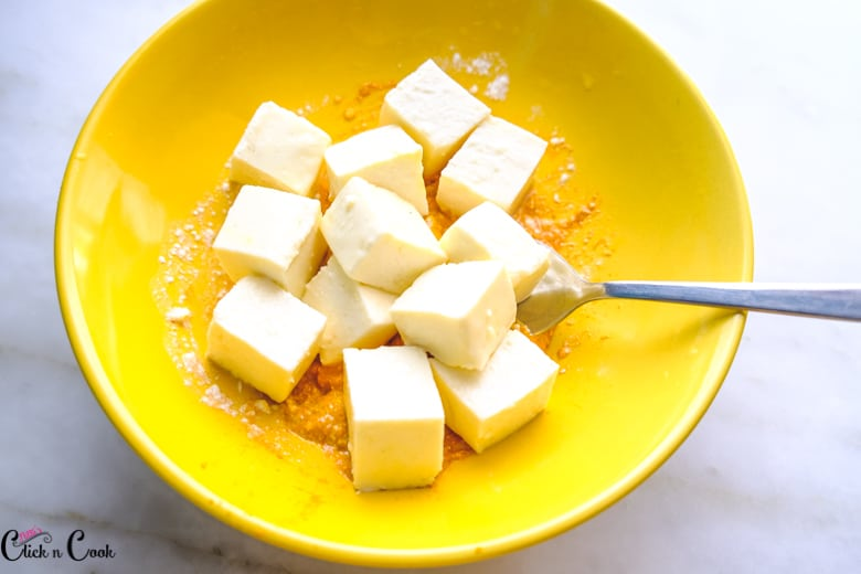 a bowl of cubed cottage cheese
