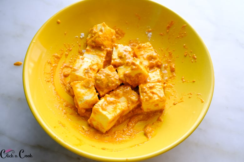 marinated cottage cheese in yellow bowl