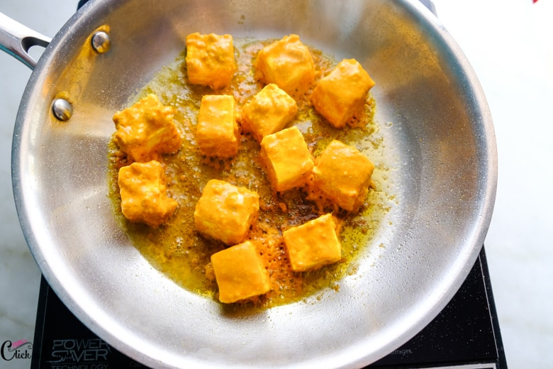 marinated paneer is being cooked