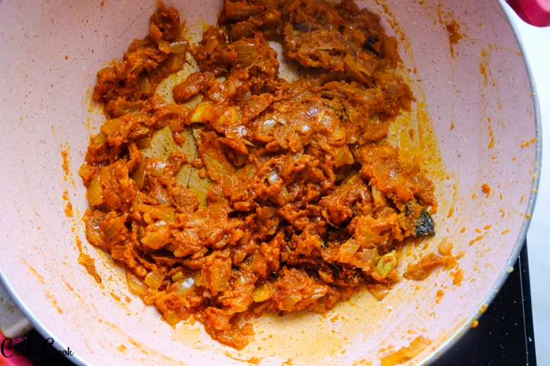 onion and tomato masala is in saute pan